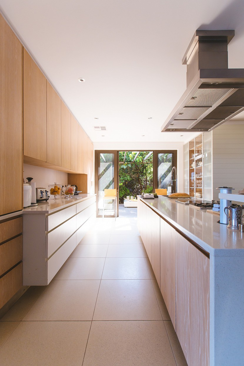 Modern kitchen looking out to a garden.