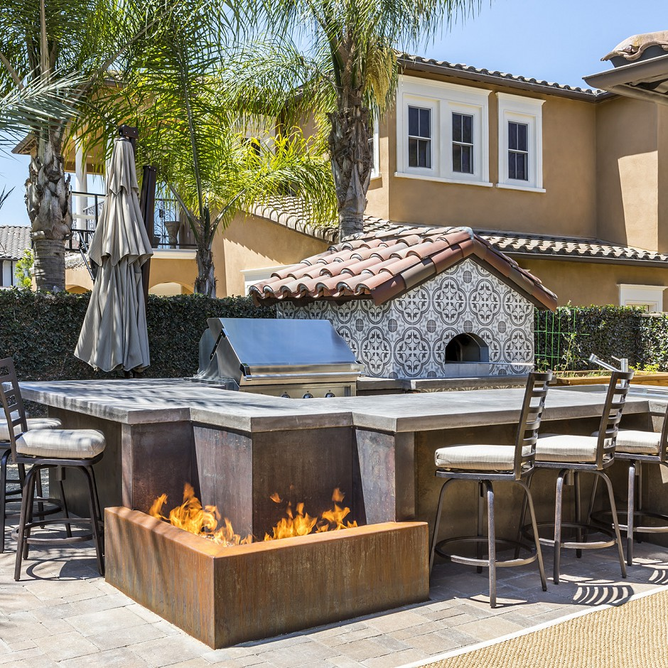 Outdoor eating area and pizza oven designed to exacting dimensions.