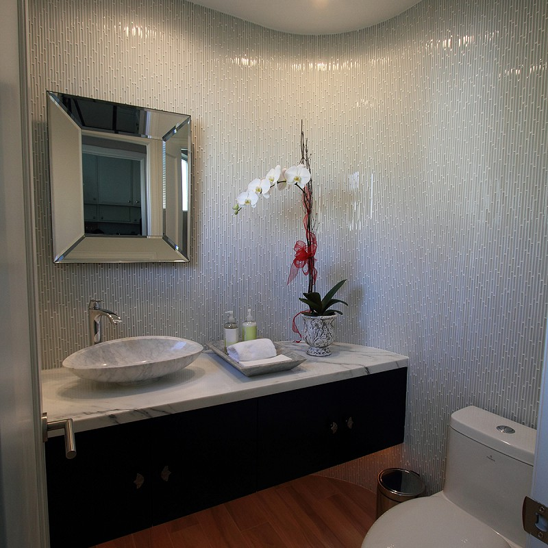 Remodeled bathroom featuring wrap-around tile.